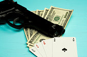 gambling weapons and money on table