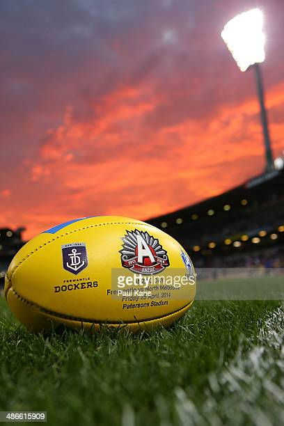 A game ball featuring an ANZAC Day logo is pictured prior to the start of the round six AFL match between the Fremantle Dockers and the North...