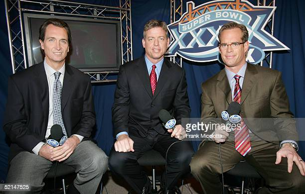 FOX game broadcasters Cris Collinsworth Troy Aiken and Joe Buck during the XXXIX Superbowl pregame show at Alltel Stadium on February 6 2005 in...