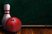 Bowling ball and pins on a background chalk board with copy space.