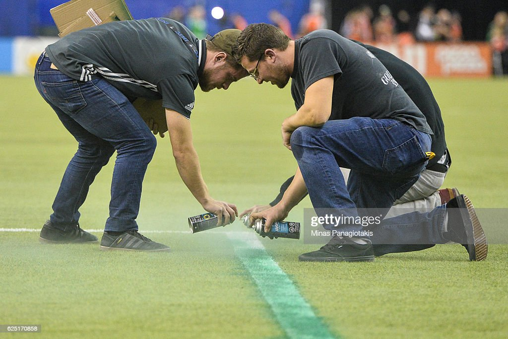 Game delayed between the Montreal Impact and the Toronto FC due to a technical error as field crews repaint the lines during leg one of the MLS Eastern Conference finals at Olympic Stadium on November 22, 2016 in Montreal, Quebec, Canada.