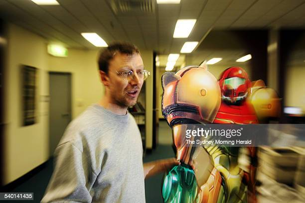 Game developer Paul McInnes with one of his previous creations a character from Metroid Prime at Microforte in Glebe Sydney 24 August 2006 SMH...