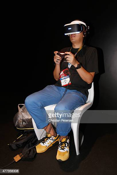 Game enthusiast Hung Chi Tang tests out the PS4 virtual reality 'Project Morpheus' during the Annual Gaming Industry Conference E3 at the Los Angeles...