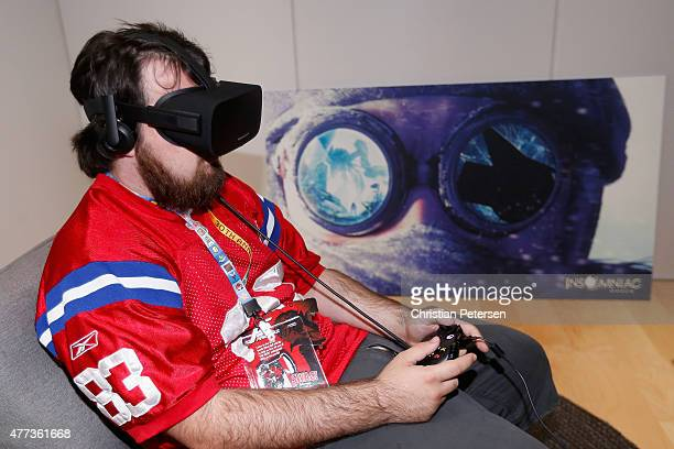 Game enthusiast Jacob Mix tests out the virtual reality headmounted display Oculus Rift CV1 at the Annual Gaming Industry Conference E3 at the Los...