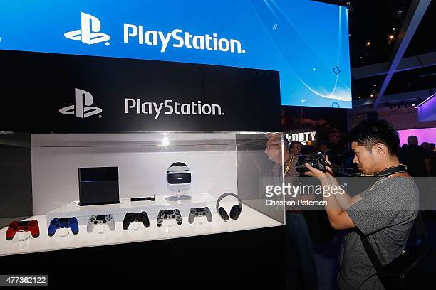 A game enthusiast takes photos of the Sony PlayStation 4 and peripherals including the virtual reality 'Project Morpheus' during the Annual Gaming...