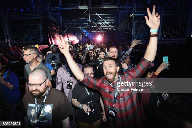 Game enthusiasts and industry personnel arrive to the Bethesda E3 conference at the LA Center Studios on June 11 2017 in Los Angeles California The...