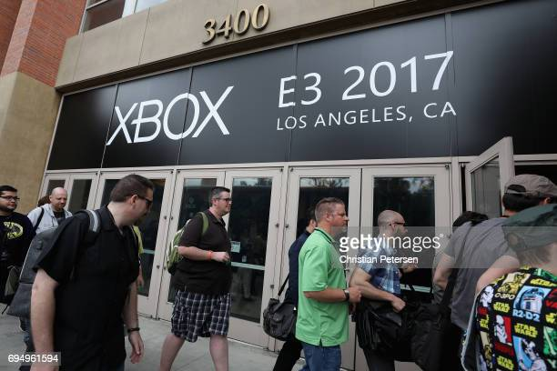 Game enthusiasts and industry personnel arrive to the Microsoft xBox E3 briefing at the Galen Center on June 11 2017 in Los Angeles California The E3...