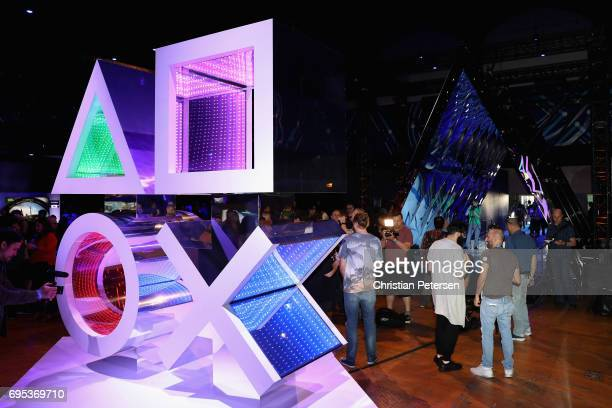 Game enthusiasts and industry personnel attend the Sony Playstation E3 showcase before the start of the conference at the Shrine Auditorium on June...