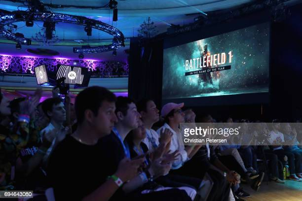 Game enthusiasts and industry personnel watch scenes from 'Battlefield One' during the Electronic Arts EA Play event at the Hollywood Palladium on...