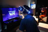 Game enthusiasts test out the PS4 virtual reality 'Project Morpheus' during the Annual Gaming Industry Conference E3 at the Los Angeles Convention...