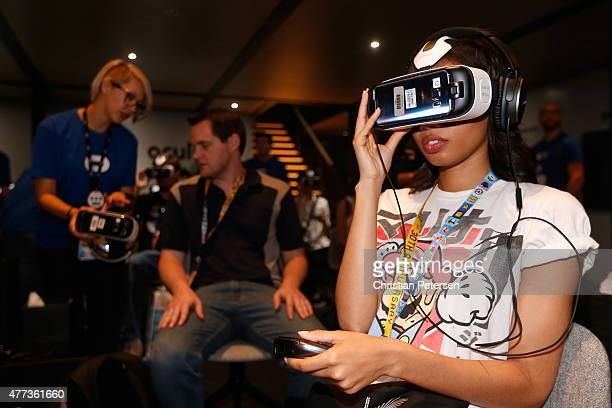 Game enthusiasts test the Samsung Gear VR powered by Oculus at the Annual Gaming Industry Conference E3 at the Los Angeles Convention Center on June...