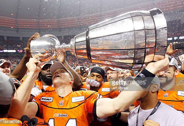 Game MVP Travis Lulay of the BC Lions hoists the Grey Cup after BC beat the Winnipeg Blue Bombers 3423 to win the CFL 99th Grey Cup November 27 2011...