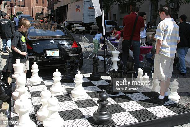 A game of chess is played at the Family Festival Street Fair during the 5th Annual Tribeca Film Festival May 6 2006 in New York City