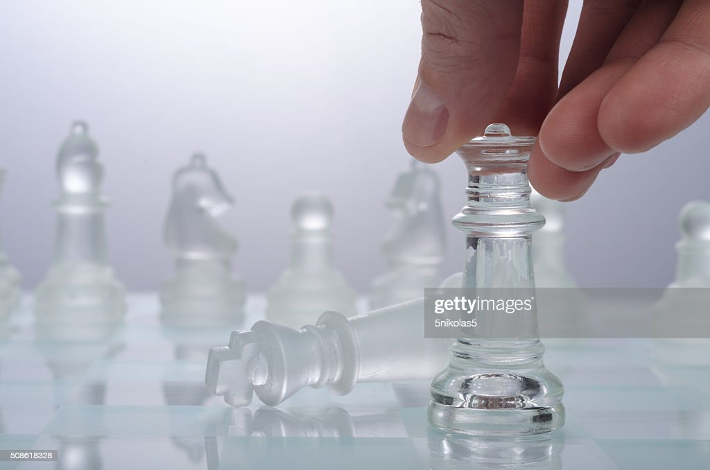 Game of glass chess on a light background : Stock Photo