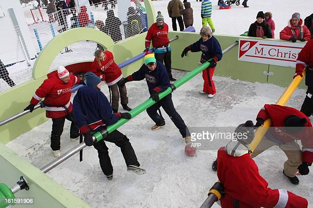 A game of human table football is played during carnival in Quebec City on February 10 Canoe Races snow baths sliding on tubes dog sledding hockey...