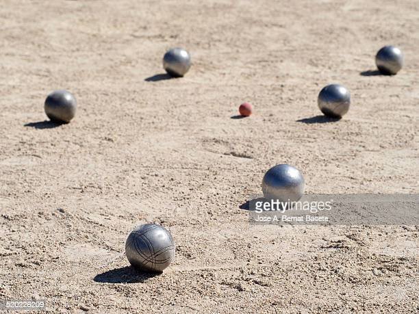 Game of the petanque with his balls on the sand