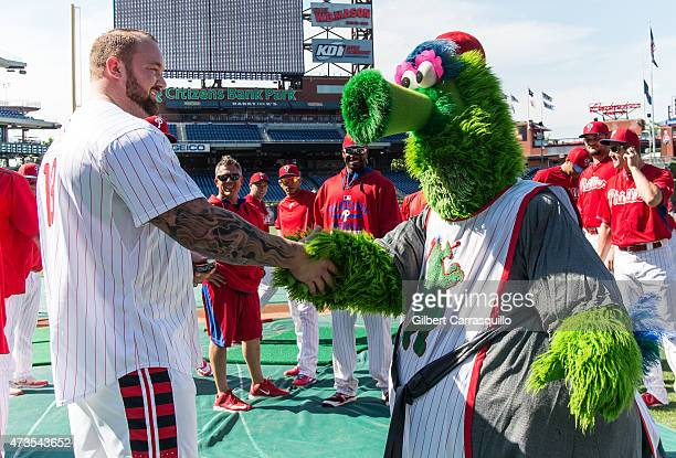 Game of Thrones actor Hafthor Julius Bjornsson meets Phillie Phanatic while participating in batting practice prior to The PhilliesDiamondbacks game...