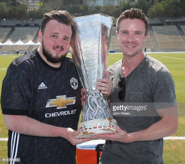 Game of Thrones actors John BradleyWest and Joe Dempsie pose with the UEFA Europa League trophy ahead of a Manchester United first team training...