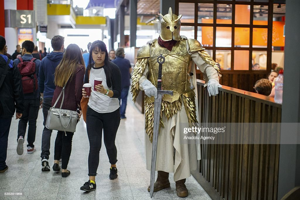 A Game of Thrones cosplayer (R) holds his sword during MCM Comic Con at ExCeL convention centre in London, England on May 29, 2016.
