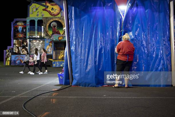 A game operator closes the Lucky Duck game at the end of the night during the Dreamland Amusements carnival in the parking lot of the Neshaminy Mall...