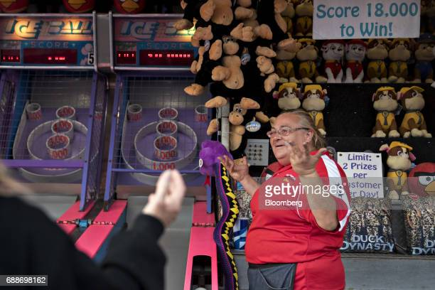A game operator reacts as a customer loses at a game of skeeball during the Dreamland Amusements carnival in the parking lot of the Neshaminy Mall in...