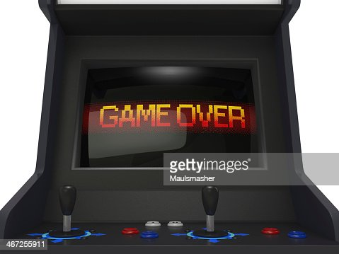 Game over screen on a black arcade game with two controllers : Stock Photo