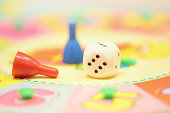 Game pieces on colorful table board macro view