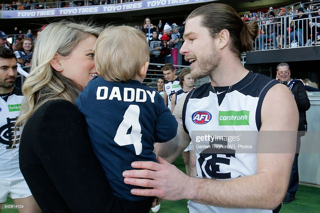 200 game player Bryce Gibbs of the Blues runs out with his son Charlie before the round 14 AFL match between the Greater Western Sydney Giants and the Carlton Blues at Spotless Stadium on June 25, 2016 in Sydney, Australia.
