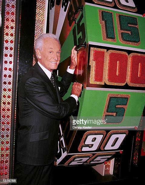 Game show host Bob Barker poses by one of the game props at CBS Studios to celebrate his 30th anniversary as host of 'The Price Is Right' June 6 2001...