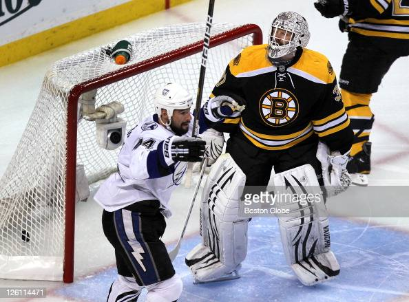 Game two of the Eastern Conference final Tampa's Nate Thompson reacts to teammate Adam Hall's first period goal past Bruins goalie Tim Thomas
