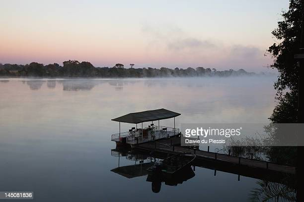 Game viewing boat on Kafue River at sunrise, Kafue National Park, Zambia, Africa