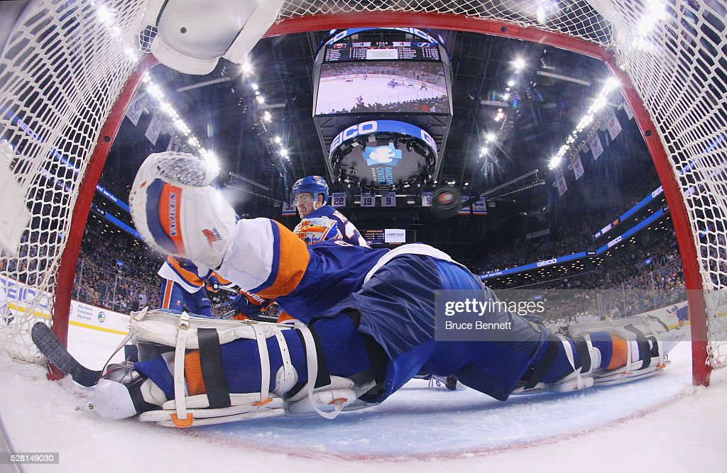 A game winning overtime shot by <a gi-track='captionPersonalityLinkClicked' href=/galleries/search?phrase=Brian+Boyle+-+Ice+Hockey+Player&family=editorial&specificpeople=8986264 ng-click='$event.stopPropagation()'>Brian Boyle</a> #11 of the Tampa Bay Lightning flies over <a gi-track='captionPersonalityLinkClicked' href=/galleries/search?phrase=Thomas+Greiss&family=editorial&specificpeople=695275 ng-click='$event.stopPropagation()'>Thomas Greiss</a> #1 of the New York Islanders in Game Three of the Eastern Conference Second Round during the 2016 NHL Stanley Cup Playoffs at the Barclays Center on May 03, 2016 in the Brooklyn borough of New York City. The Lightning defeated the Islanders 5-4 in overtime.