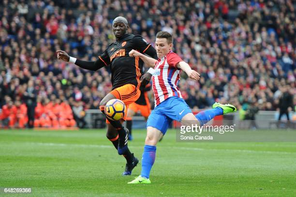 Gameiro #21 of Atletico de Madrid and Eliaquim Mangala #5 of Valencia CF during The La Liga match between Atletico Madrid v Valencia CF at Vicente...