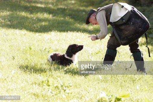 Gamekeeper instructing his dog