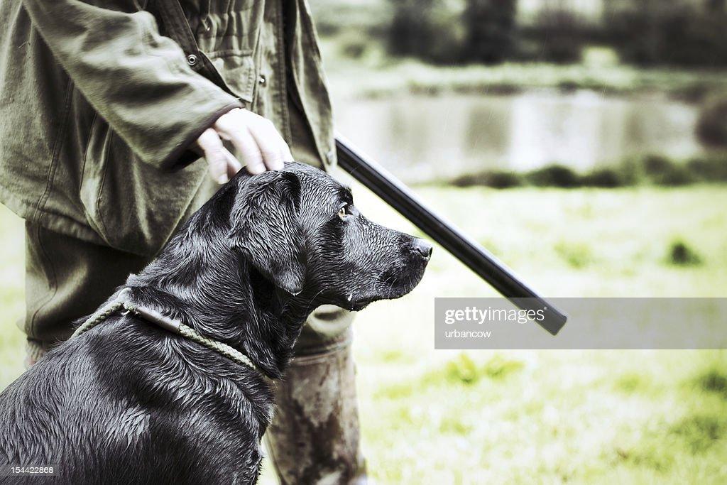 Gamekeeper  with his dog : Stock Photo