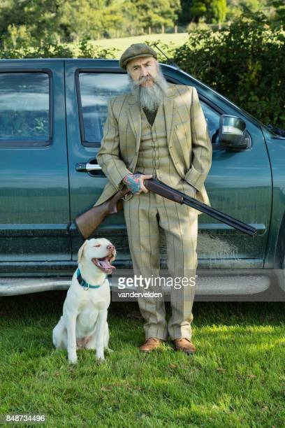 Gamekeeper with his Labrador puppy