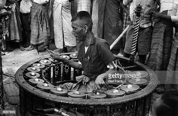 A gamelan being played in Burma Original Publication Picture Post 4748 Where Beggars are Becoming Choosers pub 1950