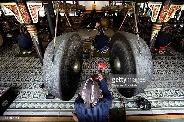Gamelan players are seen during a wayang kulit performance at the Sultan Palace in Yogyakarta on April 7 2012 in Java Indonesia