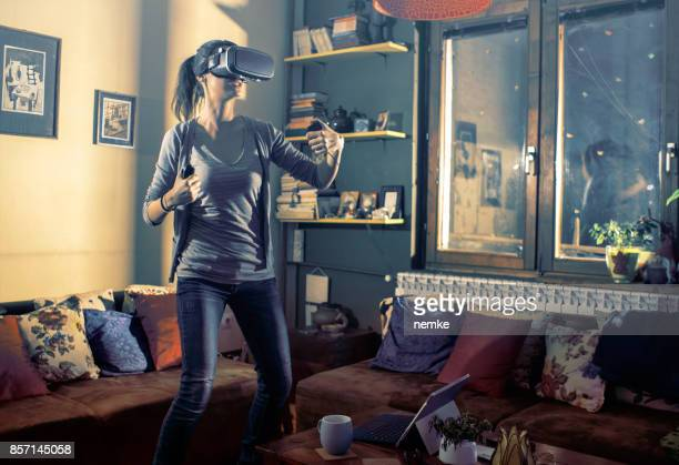 Gamer playing with virtual reality headset at smart home