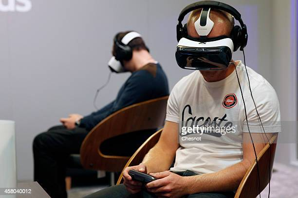 A gamer plays a game with the virtual reality headmounted display 'Oculus Rift' during the International Games Week on October 29 2014 in Paris...