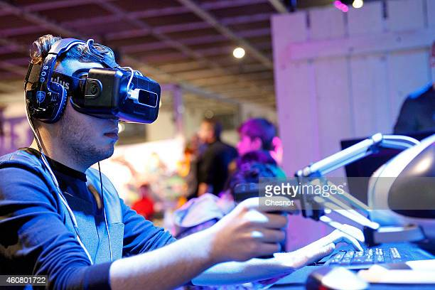 A gamer plays a game with the virtual reality headmounted display 'Oculus Rift' during the 'Noel de Geek' at the Cite des Sciences et de l'industrie...