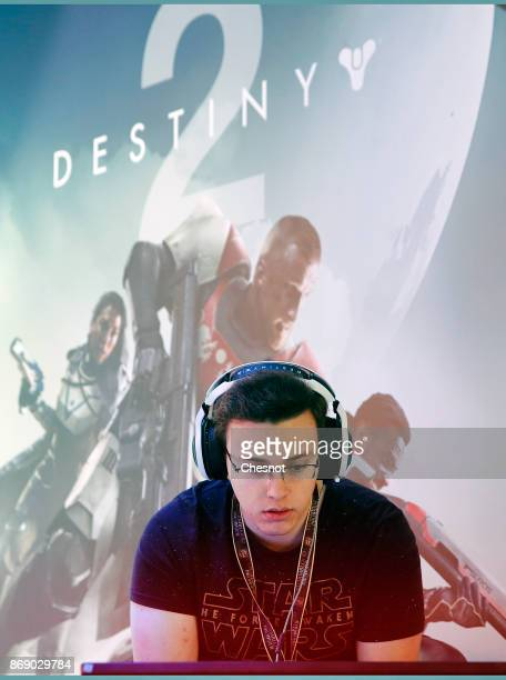 A gamer plays the video game 'Destiny 2' developed by Bingie Studios and published by Activision on a Sony PlayStation game console PS4 Pro during...