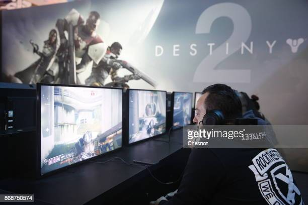 A gamer plays the video game 'Destiny 2' developed by Bungie Studios and published by Activision during the 'Paris Games Week' on October 31 2017 in...