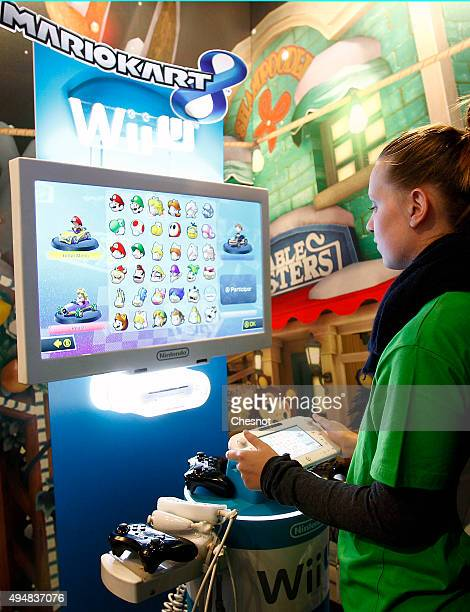 A gamer plays the video game 'Mario Kart 8' developed by Nintendo EAD on a games console Nintendo Wii U at Paris Games Week a trade fair for video...