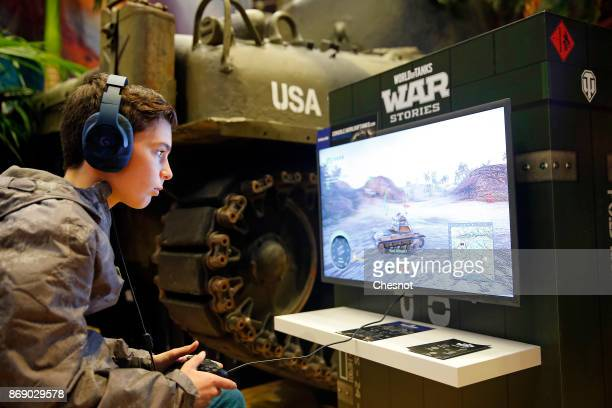 A gamer plays the video game 'World of Tanks War Stories' developed and published by Wargamingnet on Sony PlayStation game consoles PS4 Pro during...
