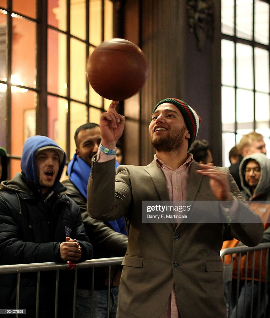 A gamer queuing in Covent Garden ahead of the launch of the Playstation 4 entertains himself by playing with a basketball on November 28, 2013 in London, England. PS4 consoles go on sale at midnight.