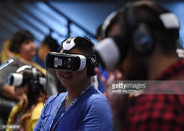 A gamer tests a new Virtual Reality game headset at the Oculus display on the second day of the Electronic Entertainment Expo known as E3 at the...