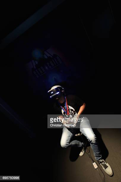Gamer Thiago Barbosa Neres tests the PlayStation VR game 'StarChild' during the Electronic Entertainment Expo E3 at the Los Angeles Convention Center...