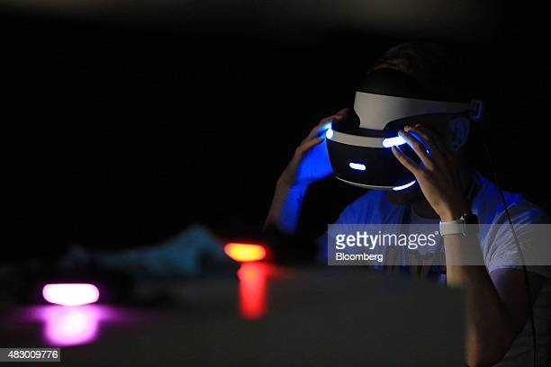 A gamer wears a Project Morpheus virtual reality headset developed by Sony Computer Entertainment Inc at the Gamescom video games trade fair in...