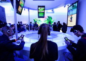 Gamers check out the new Nintendo video games after Nintendo's news conference at the Electronic Entertainment Expo 2013 at the Los Angeles...